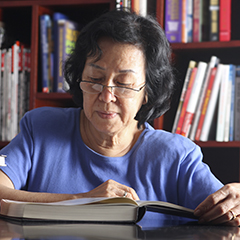 Older student reading in the library