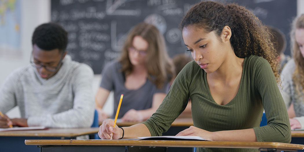 high school students working in class