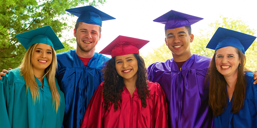 Five students in their caps and gowns